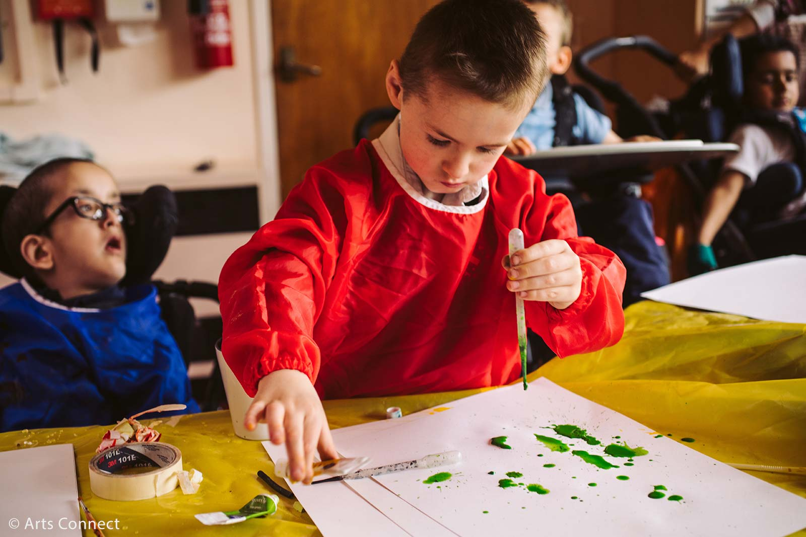 Primary aged boy with paint